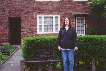 Sharon posing in front of Paul McCartney's childhood home